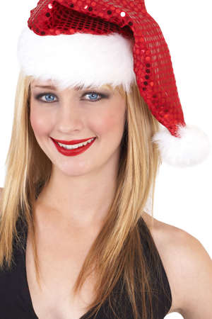 20 25: Portrait of a beautiful blonde woman with light blue eyes and colorful make-up wearing Christmas hat isolated on white background