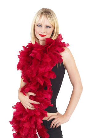 Portrait of a beautiful blonde woman with light blue eyes and dramatic make-up wrapped in red fur boa isolated on white background photo