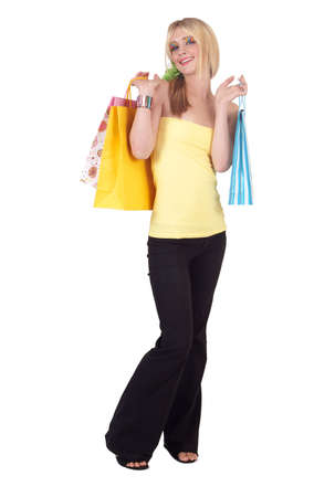 Beautiful blonde woman with light blue eyes and colorful make-up holding shopping bags isolated on white background photo