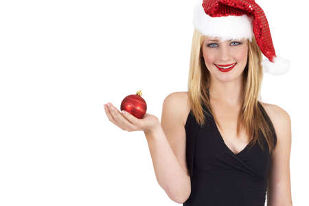 20 25: Portrait of a beautiful blonde woman with light blue eyes and colorful make-up wearing Christmas hat and holding red ball isolated on white background