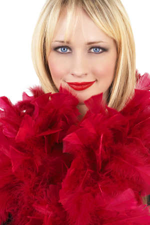 Portrait of a beautiful blonde woman with light blue eyes and dramatic make-up wrapped in red feather boa isolated on white background Stock Photo - 3942872