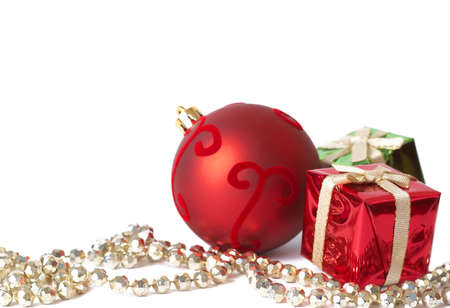 Colorful Christmas gift boxes, red ball and golden jewelry isolated on white background with copy space photo