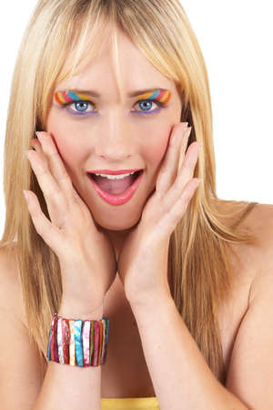 Portrait of a beautiful blonde woman with light blue eyes and colorful make-up screaming in shock or surprise isolated on white background photo