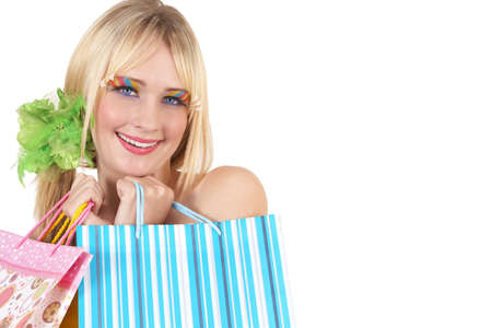 Portrait of a beautiful blonde woman with light blue eyes and colorful make-up holding shopping bags isolated on white background photo