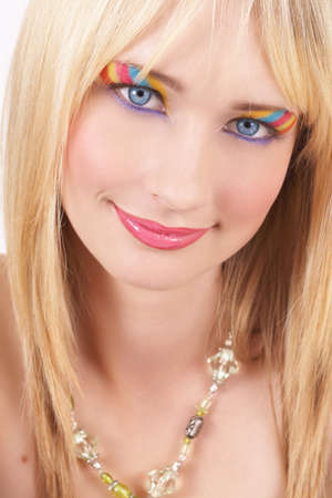 20 25: Portrait of a beautiful blonde woman with light blue eyes and colorful make-up on white background