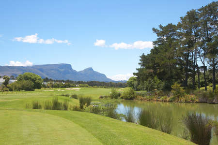 Golf course landscape in the mountains on a beautiful summer day with blue skies photo