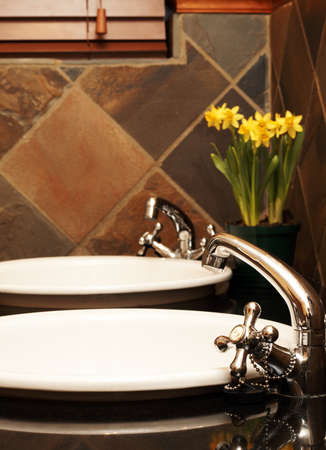 Beautiful bathroom with white sinks, granite tops and rustic tiles Stock Photo - 4361140