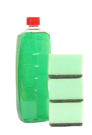Three washing sponges and bottle with chemicals isolated on white background photo
