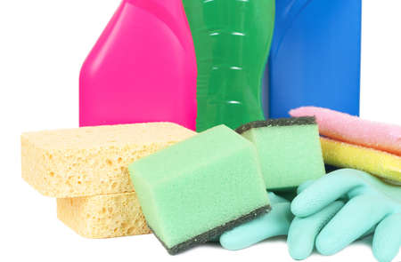 Variety of cleaning products such as sponges, gloves, and bottles with chemicals isolated on white background photo