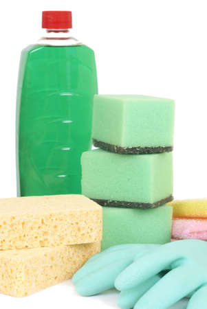 Variety of cleaning products - sponges, gloves, and bottle with chemicals isolated on white background photo