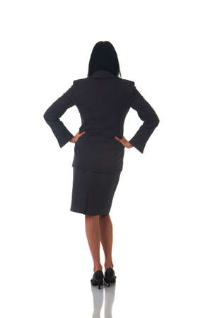 Beautiful brunette businesswoman in business suit standing in a confident pose on white background. Not isolated Stock Photo - 5643274