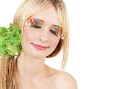 Portrait of a beautiful blonde woman with colorful make-up on white background, not isolated photo