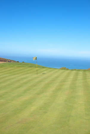 Golf course landscape with a view onto the ocean on a beautiful summer day photo