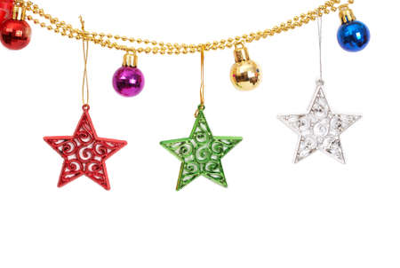 Four colorful Christmas baubles and stars on golden string isolated on white background with copy space.  photo