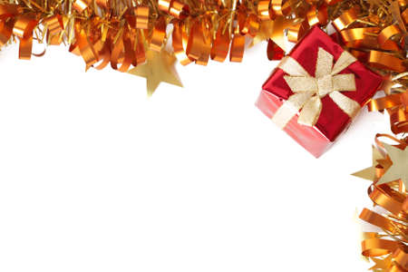 Red Christmas gift with golden tinsel frame isolated on white background with copy space.  Stock Photo