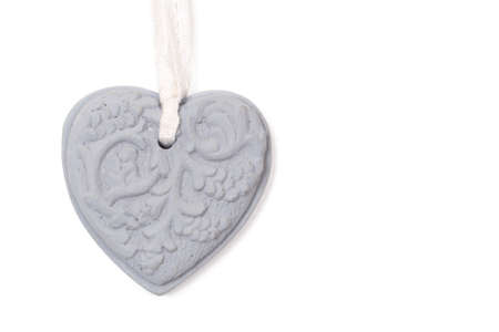 Grey stone heart with patterns on white background photo