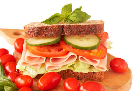 Tasty smoked ham, tomato and cucumber sandwich on wholewheat bread photo
