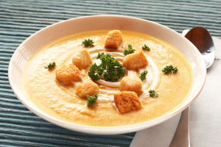 butternut: Bowl of fresh hot butternut soup with cream, parsley and croutons