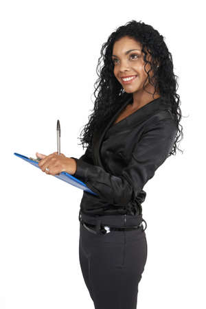 Beautiful brunette businesswoman wearing office clothes holding clipboard and pen in her hands. On white background with copy space photo