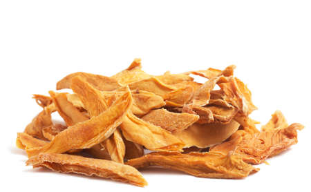 Stack of dried mango slices isolated on white background Stock Photo