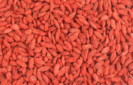 lycium: Red dried goji berries (Lycium Barbarum - Wolfberry) forming a background Stock Photo