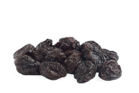 dried plums: Stack of dried plum prunes on white background Stock Photo