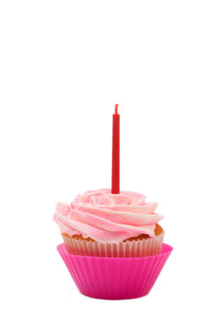 buttercream: Fresh vanilla cupcake with rose buttercream icing and birthday candle on white background Stock Photo