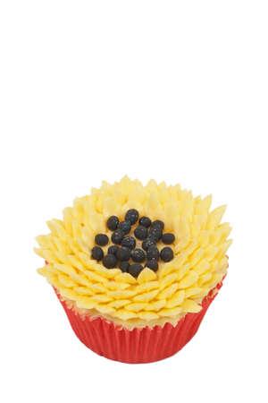 buttercream: Fresh vanilla cupcake with sunflower buttercream icing decoration on white background