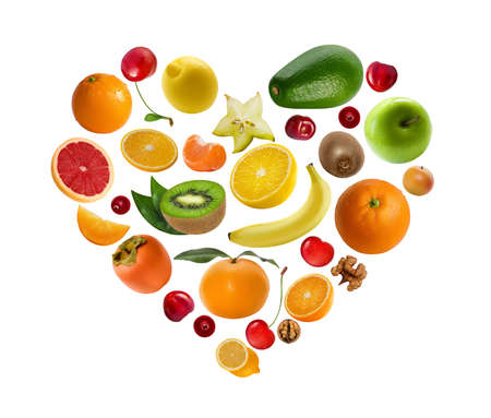 A lot of fruits and berries lie in the shape of heart isolated on white background. Vitamin kit.
