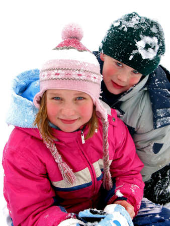 Boy and girl having fun in the fresh white snow photo