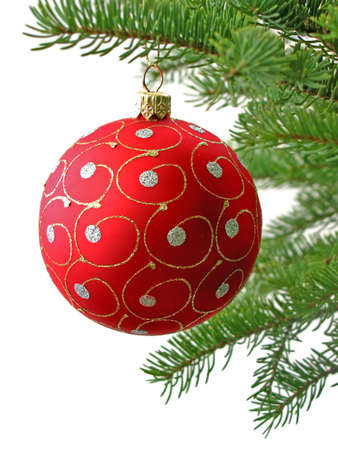 Red Christmas ball on Christamas tree branch isolated on white background photo
