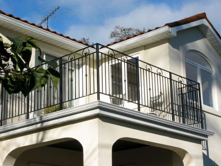 dwelling: Detail of a new home with balcony