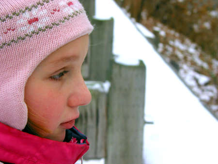 Portrait of a young girl wearing winter hat, profile Stock Photo - 351688