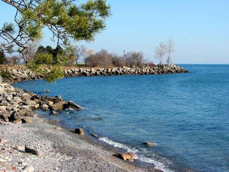 Picturesque rocky shore of a cozy bay, lake Ontario photo