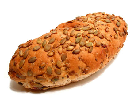 Loaf of artisan pumpkin seed and cranberry bread on white background