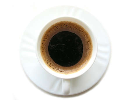 foamy: Foamy espresso coffee in a white cup with saucer on white background, top view, space for text
