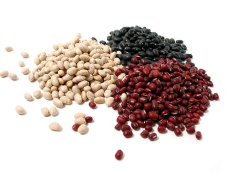 Dry white, red, and black beans on white background