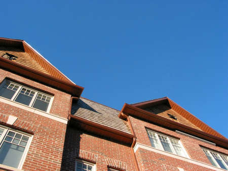 New brick townhomes on a bright sunny day, space for copy photo