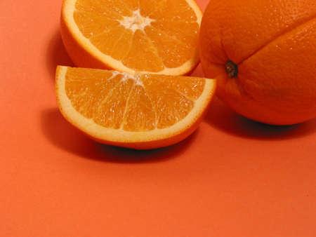 Fresh oranges on orange background, space for copy