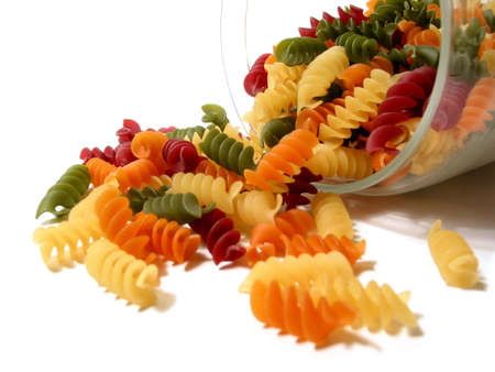 Colorful pasta in a glass jar isolated on white background photo