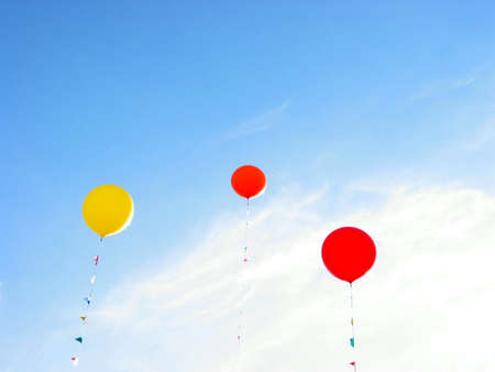 coloful: Colorful balloons flying in blue sky on a bright summer day