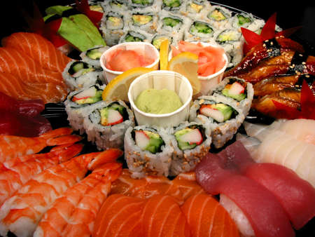 Party tray of sushi and rolls, closeup