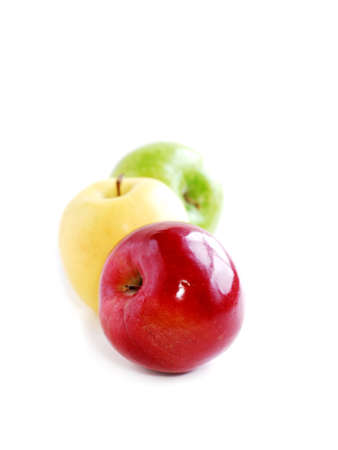 Three apples on white background in perspective: green, yellow and red Stock Photo - 353237