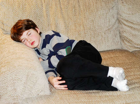 Cute little boy sleeping on a couch