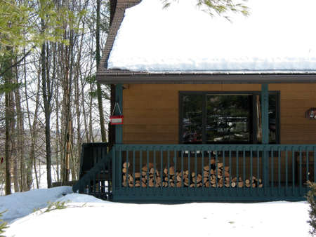 Log cabin in the forest at winter time photo