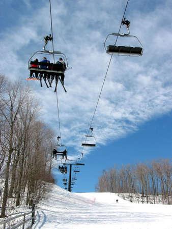 Downhill ski chairlift on a ski resort on bright sunny day