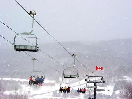 Chairlift at Horseshoe ski resort during heavy snowfall photo