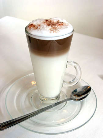 capuccino: Layered latte in a tall glass Stock Photo