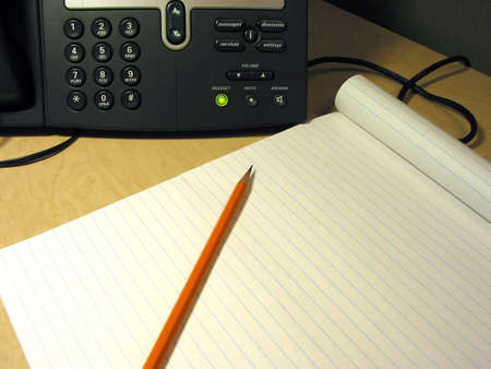 ip: IP phone on the desk in the office with pencil and notepad Stock Photo
