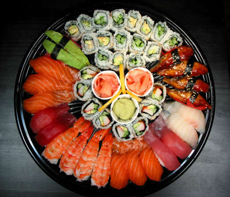 Party tray of sushi and rolls